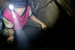 A miner enters a tunnel in Maragusan, Compostela Valley, Philippines.